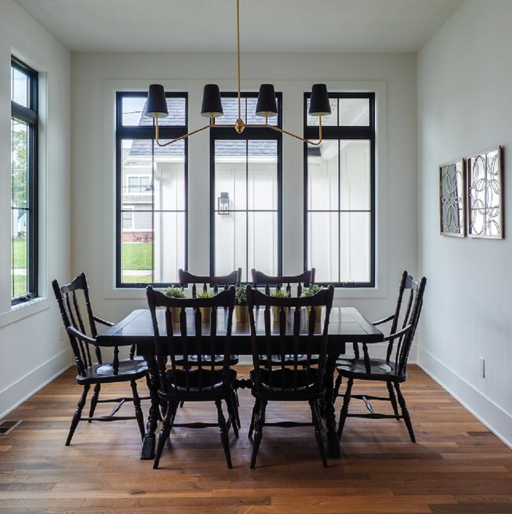 kitchen table with multiple windows surrounding the room
