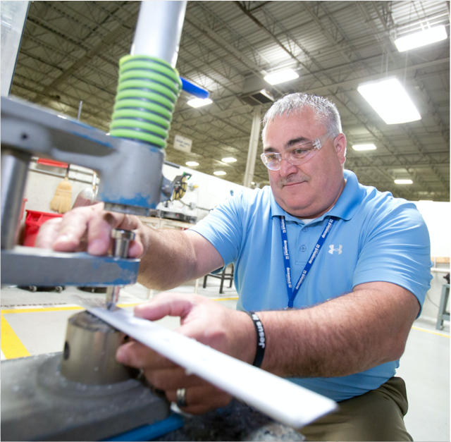 Technician testing a high performance window system component